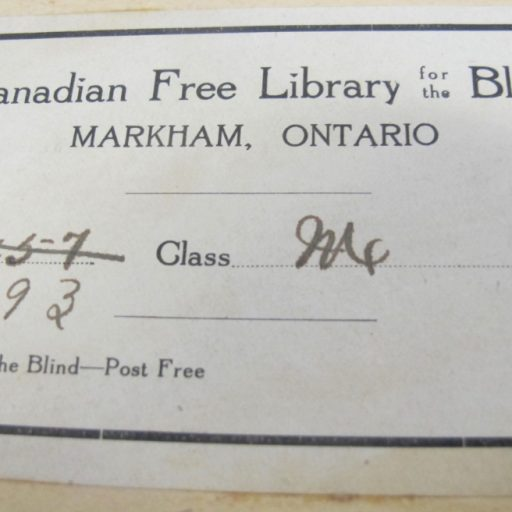 Paper label showing the text transcribed in the description