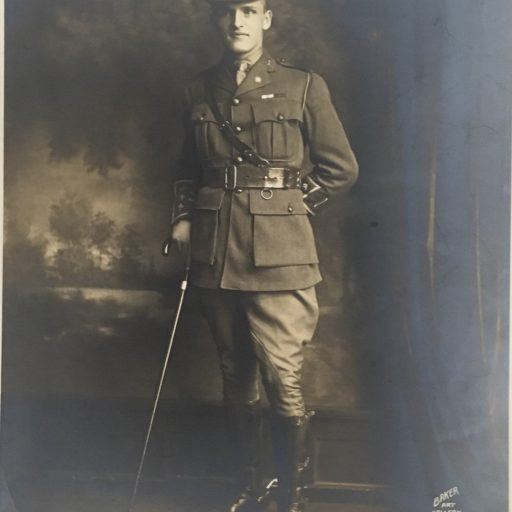E.A. Baker in full dress uniform, standing with black cane in front of a landscape. Signed E.A. Baker, Baker Art Gallery