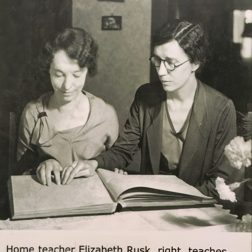 Home teacher Elizabeth Rusk, right, teaches Edna Sharpe to read braille, 1934. Caption in Annual Report reads - The Blind Teach the Blind, a lesson in braille being given by one of our home teachers