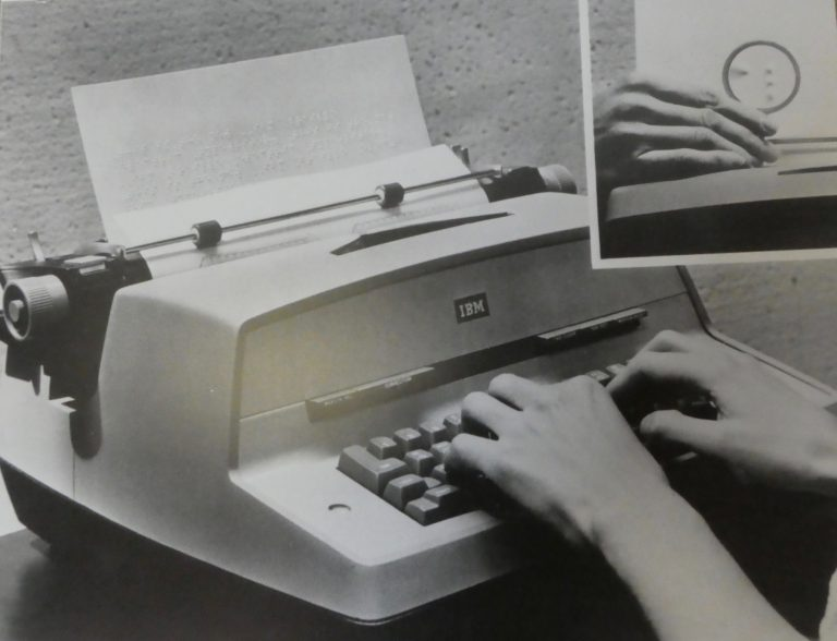 A typewriter with two hands on the keyboard and an insert of a close up braille character