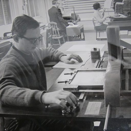 Operator in the foreground at the stereotype machine, two other staff in the background